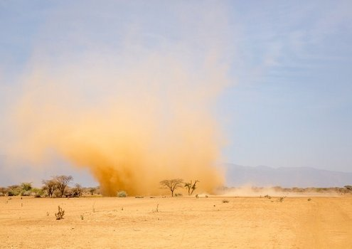 A dust storm during the dry season in Olkiramatian in the Kenyan Rift Valley.
