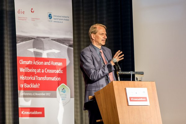 "Dirk Messner, Director of DIE, at the conference ""Climate Action and Human Wellbeing at a Crossroads: Historical Transformation or Backlash?"" <br/> Photo: DIE"