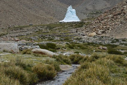 Ice stupa in Himalayan landscape.