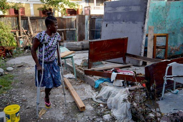 Marie Ange from Haiti standing in front of the ruins of her house in the wake of Hurricane Matthew. The new app can provide those helping after a disaster with practical advice.