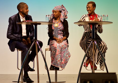 Charles Batte (left), Hindou Oumarou (centre) and Uwase Hirwa Honorine discussing community-level action.